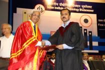 Director hands over the first Ph.D. degree